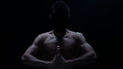 Muay thai Silhouette. Silhouette of a Thai fighter in the dark. Concept of balance
