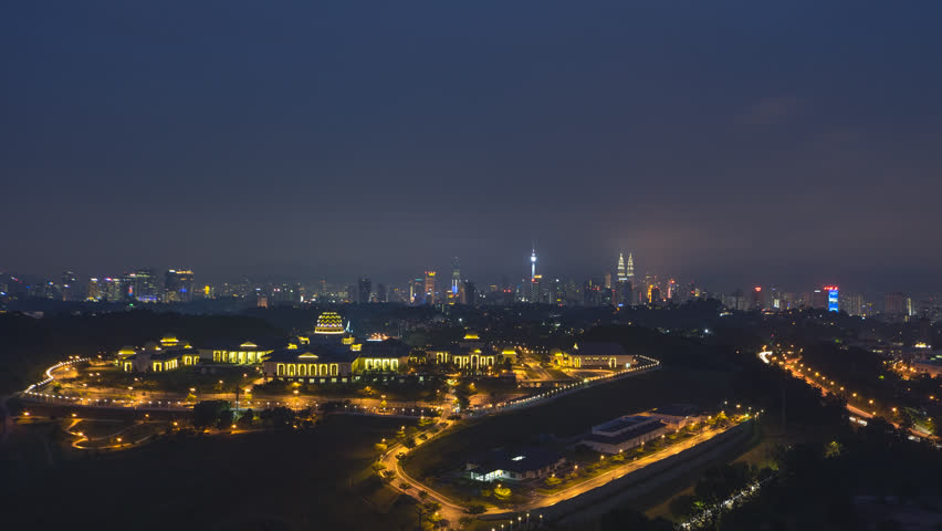 Time lapse: Dramatic night aerial view of the Kuala Lumpur skyline overlooking the national palace in the foreground and the national landmarks in the background. Prores Full HD 1080p. 4K available. | Shutterstock HD Video #1015296811