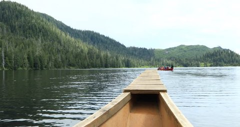 Paddle the canoe through an isolated lake.