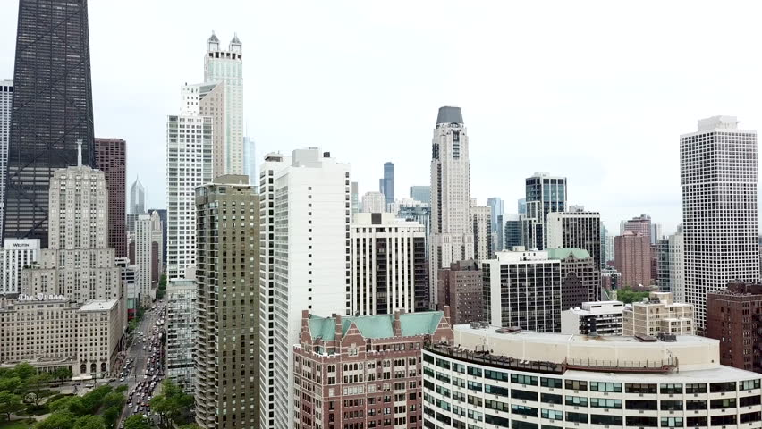 Aerial video of Chicago Illinois between buildings