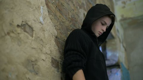 Pallid boy slowly fainting after using drugs, problem of addiction among youth
