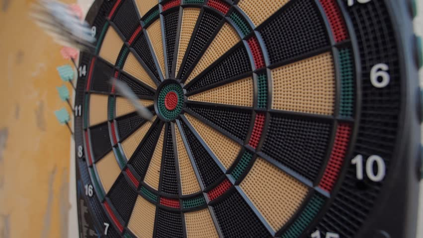 Close up shot of a dart board. Darts arrow Missing the target on a dart board during the game.