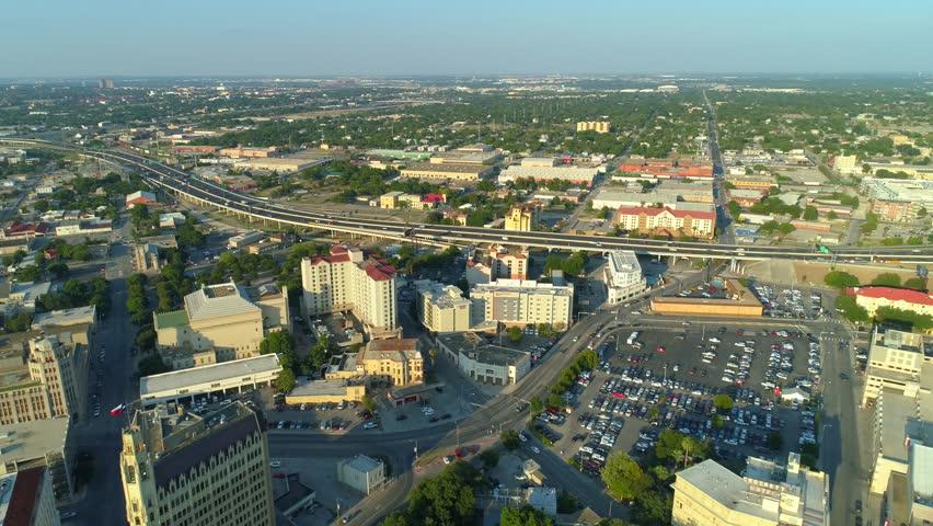 Aerial backwards flight San Antonio Texas city footage