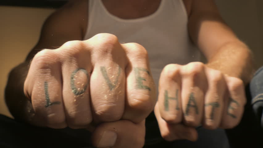 Man showing LOVE and HATE tattoo letters on hands closeup  | Shutterstock HD Video #1015407931