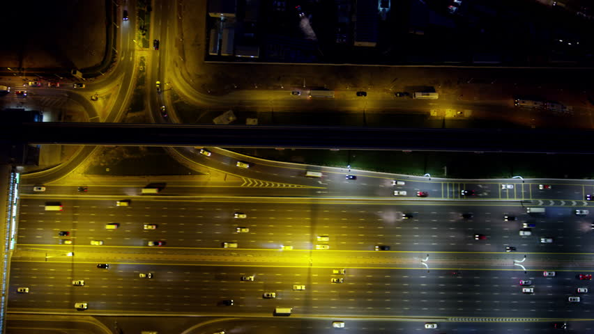 Aerial night overhead illuminated view city highway commuter vehicle traffic metro rail commercial area modern vehicle transport system UAE Middle East Dubai RED WEAPON | Shutterstock HD Video #1015415281