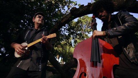street band playing in park city brazil rio de janeiro instrumental musicians concert live group culture