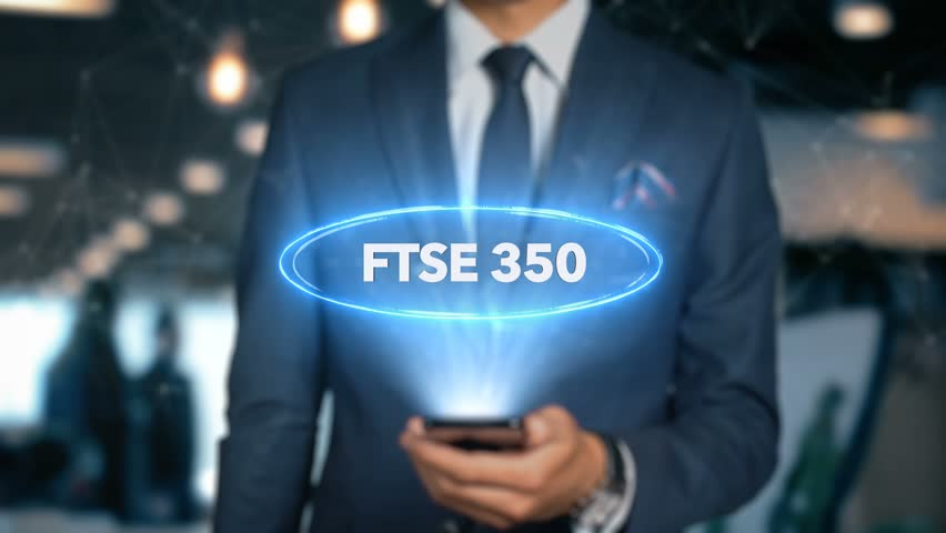 Businessman With Mobile Phone Opens Hologram HUD Interface and Touches Word - FTSE 350