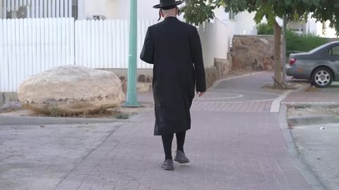 An Orthodox Jew walking away from the camera