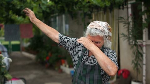 Grandmother shows a fashionable youth movement dab. Modern dance, sense of humor