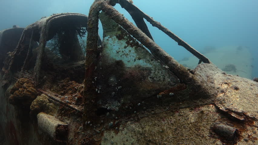 Move along side of cockpit of wreck of seaplane in Palau.