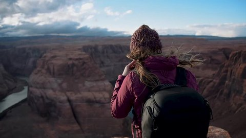 Woman Looking Out at Horseshoe Bend in Grand Canyon