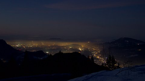 Timelapse of Salzburg in the night as seen from the Rossfeld Panorama street on a cold winter night with a really clear view.
