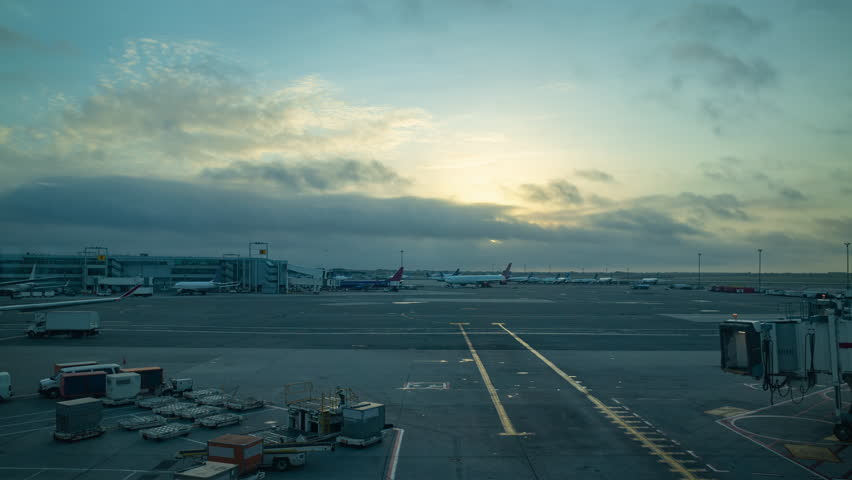 Busy airport at sunrise