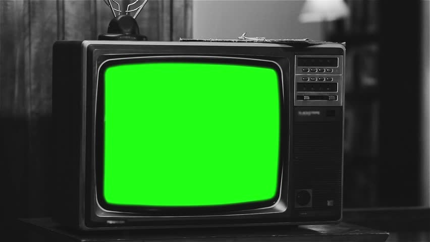 "Old 1980s TV with Green Screen. Black and White Tone. Zoom In. Ready to Replace Green Screen with any Footage or Picture you Want. You Can Do It With ""Keying"" (Chroma Key) Effect.   