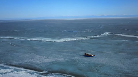 Transportation by hovercrafts on Baikal lake, Russia. Aerial view.