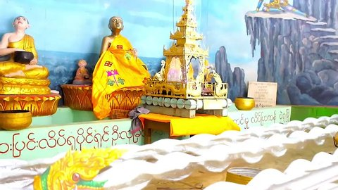 BAGO, MYANMAR - FEBRUARY 15, 2018: The scenic installation in Shwemawdaw Pagoda pavilion - the stormy waters in front of Buddha images, on February 15 in Bago.