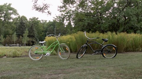 HD A shot of two bycicle standing nearby in the park