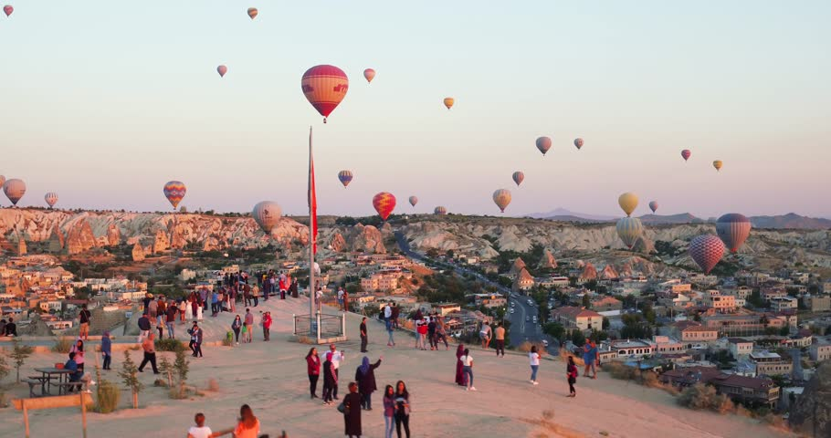 4K Aerial view of Goreme. Colorful hot air balloons flying over the valleys. Famous city Cappadocia, Turkey. #1015809451