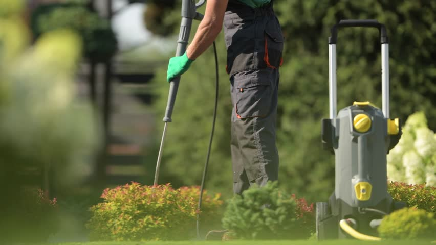 Summer Cleaning Time in the Garden. Washing Paths Using Pressure Washer | Shutterstock HD Video #1015850731