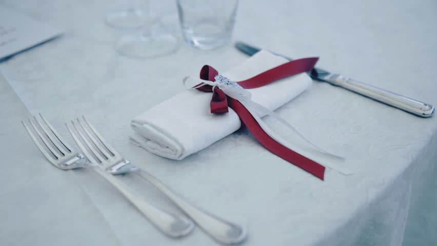 Decorated table for a wedding dinner. Close up of elegant, decorated table prepared for a luxury dinner.