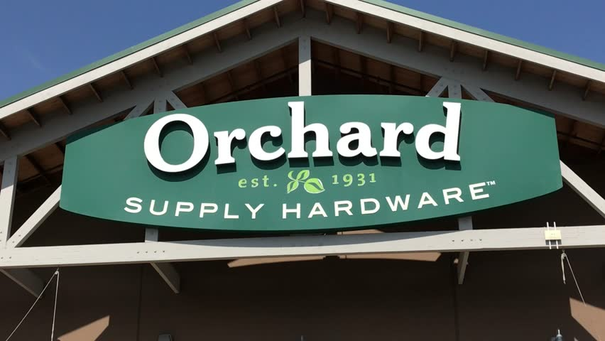 LOS ANGELES, Sep 1,2018: Close up of an OSH Orchard Supply Hardware store sign and logo above a West LA store, then pan down to entrance and customers entering store. The chain is set to close October