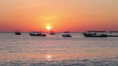 Beautiful sunrise with nice paradise beach. Amazing Sunset / sunrise over water. Pemuteran, Bali, Indonesia. Typical Balinese Fishing Boats. Sea.