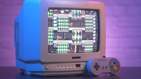 MONTREAL, CANADA - September 2018 : Retro Nintendo Mario video game being played on a old vintage TV screen 80s 90s style.