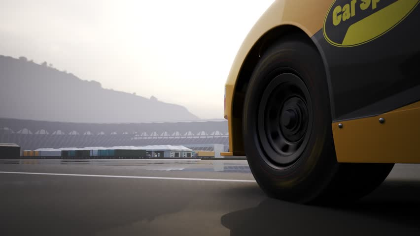 High speed racing car driving and drifting around racing track. Close-up on the front wheel.