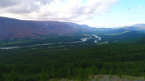 View of the Sob river valley on a cloudy August evening. Polar Urals, Russia (aerial)