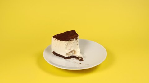 Eating a piece of cake on a white dish - Stop motion