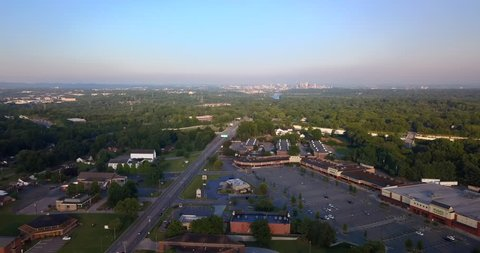 Aerial drone footage over strip mall retail center with Nashville Skyline off in the distance,?