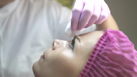 Cosmetologist doing beauty injection to woman face in cosmetic clinic. Close up young woman getting cosmetic injection. Anti aging, anti wrinkles and skin face care. Plastic surgery clinic