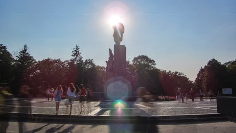 Taras Shevchenko Monument timelapse in Shevchenko park (to Ukrainian famous poet and thinker) with his poetic images of fighters for freedom. Sun moves behind this monument