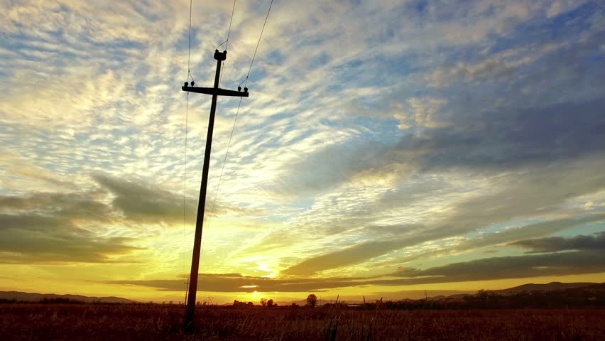 Electric post and Power lines at sunset #1016031451