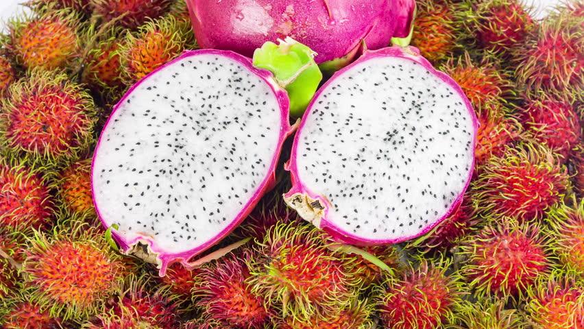 Exotic Tropical Thai Fruit Rambutan and Dragon Fruit at Farmers Market closeup