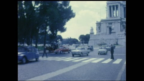 Road with crossing and traffic in Rome, 1950's. 8mm film. Vintage footage.