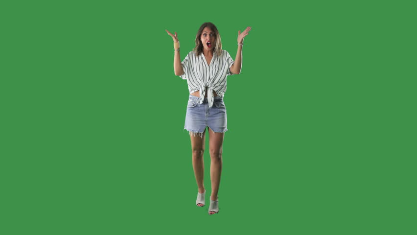 Happy young surprised and amazed woman full body portrait over green screen background #1016088511