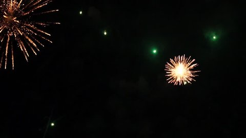 Beautiful Colorful Fireworks Background. Dark Sky And Color Lights. Slow Motion And Close Up.