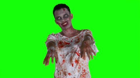 Creepy bloody zombie man with wounds in the studio, shot in 4k resolution with green screen background