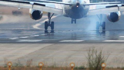 Long shot of jet plane landing on runway