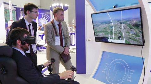 KUBINKA, MOSCOW OBLAST, RUSSIA - AUG 22, 2018: International military-technical forum ARMY-2018. Visitors learn aviation simulator