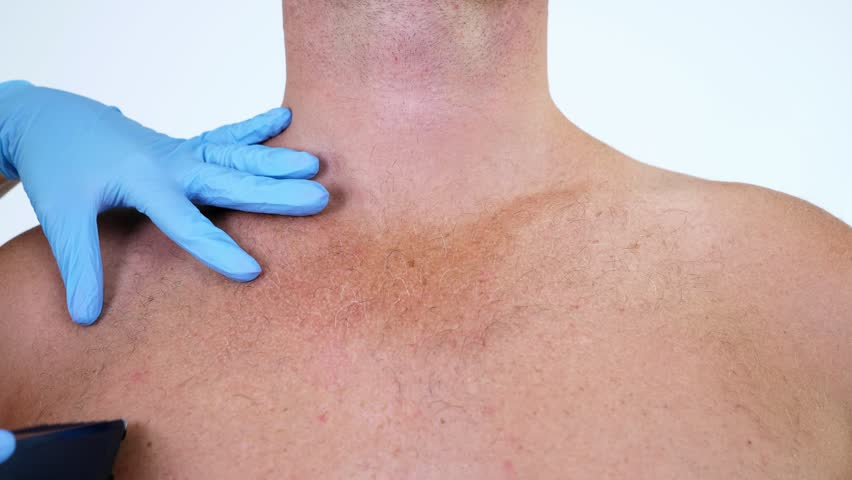 Close-up, cosmetologist female hands in gloves haircut body hair of a Naked hairy Man, his chest, Torso, whole body with a clipper, electric razor, trimer. on white background.