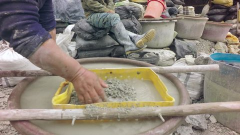 Hands Washing Little Stones To Find Gold On A Plastic Tub At A Mining Plant In Chinapintza Ecuador
