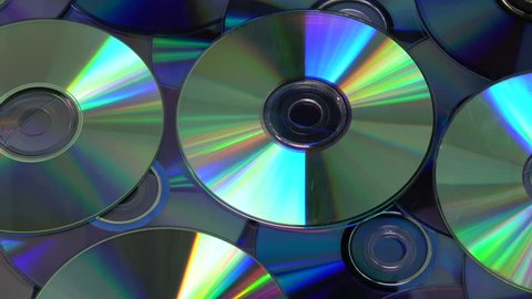 Rotating colorful shiny many DVD and CD compact discs background