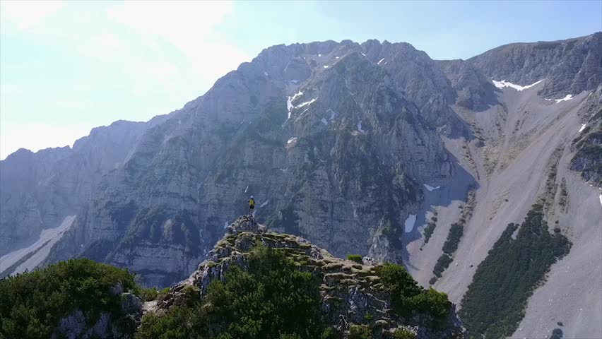 Aerial shot of hiker on top of the mountain ridge | Shutterstock HD Video #1016214361
