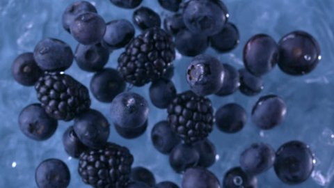 Blackberries and Blueberries. Slow motion.