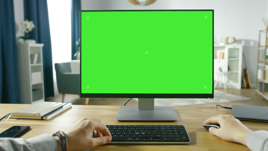 First Person View of Professional Freelancer Working on Green Mockup Screen Personal Computer From Home. Close-up POV Shot. In the Background Cozy Living Room. Shot on RED EPIC-W 8K Helium Camera. | Shutterstock HD Video #1016262031