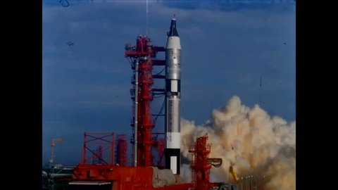 CIRCA 1960s - A Project Gemini rocket lifts off from Launch Complex 19 at Cape Kennedy Air Force Station in Florida and a spacecraft orbits the earth.
