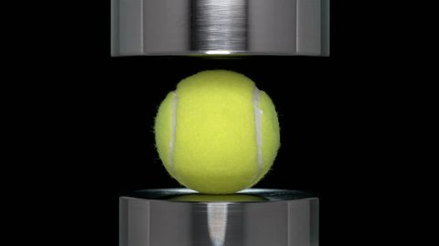 the ball from the big tennis presses hydraulic press, close-up