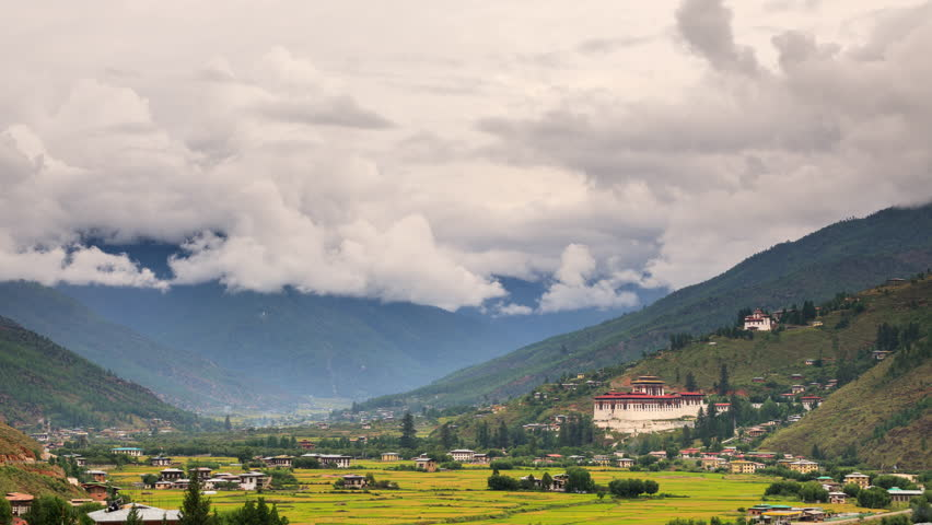 Looking out over the city of Paro in Bhutan. The Rinpung Dzong can be seen. Time Lapse.
